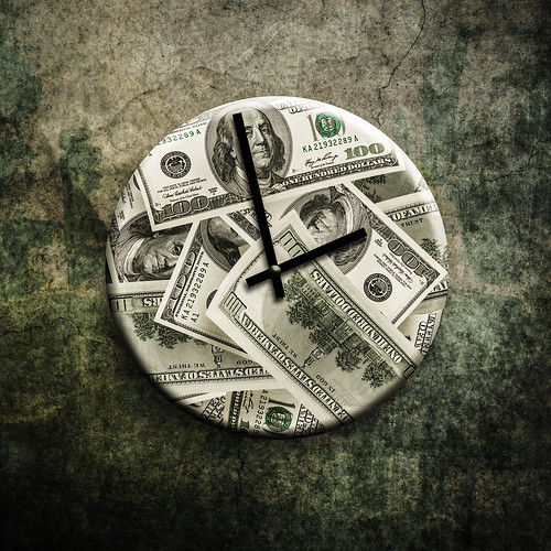 Money Clock - Image via Flickr by Tax Credits