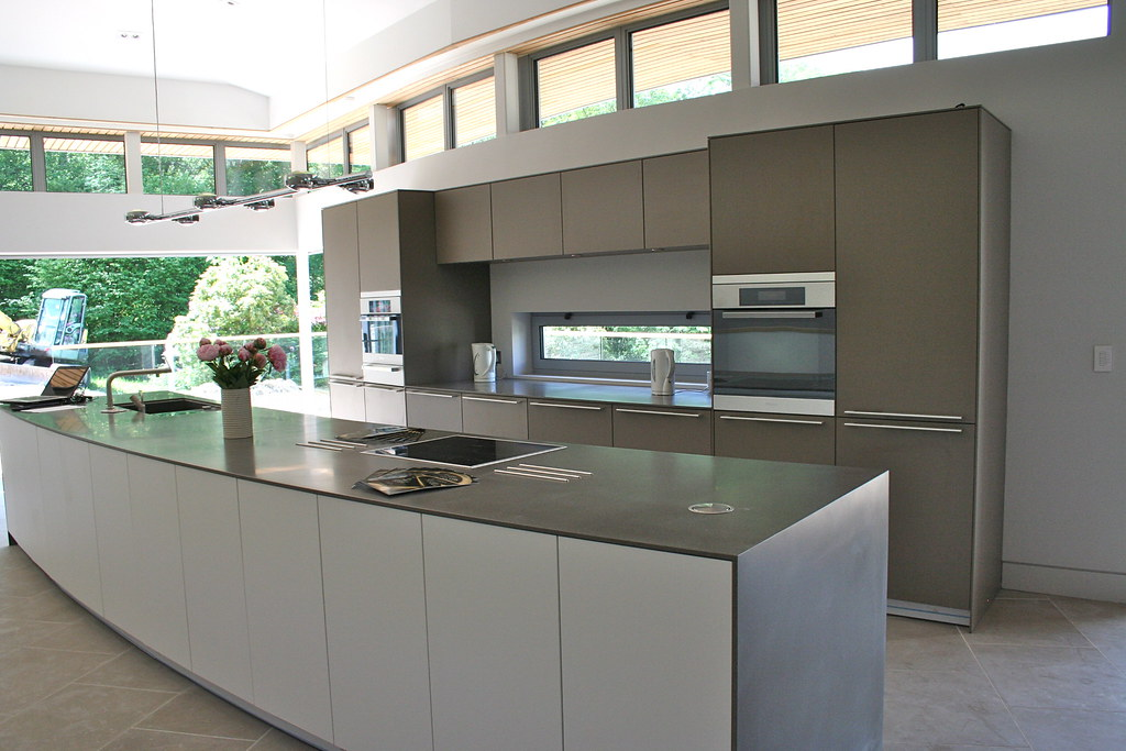 Grey bulthaup b3 kitchen with corian sides and top in curv