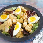 Caesar Salad with Eggs, Crispy Prosciutto, and Parmesan Wafer