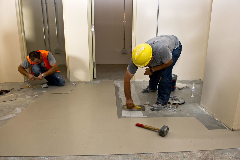 Workers Lay Vinyl Tile In Hangar Project Kaf Usace Photo Flickr