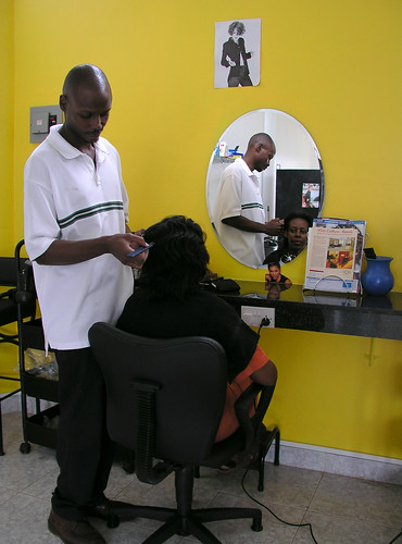A barber shop in Kampala | by World Bank Photo Collection