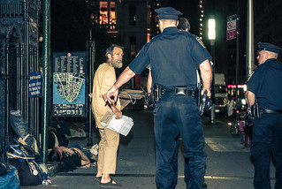 Occupier facing off with White Shirt cop outside Trinity Church | by juliacreinhart
