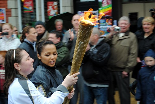 Victoria Kinsley with the torch in flame | by zawtowers