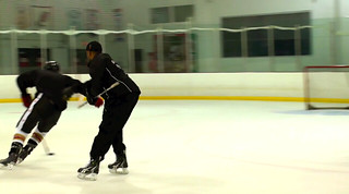 Brad Perry working on puck protection with a student | by Brad Perry