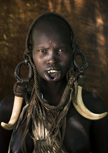 Mursi woman with tusks, Omo Ethiopia | by Eric Lafforgue