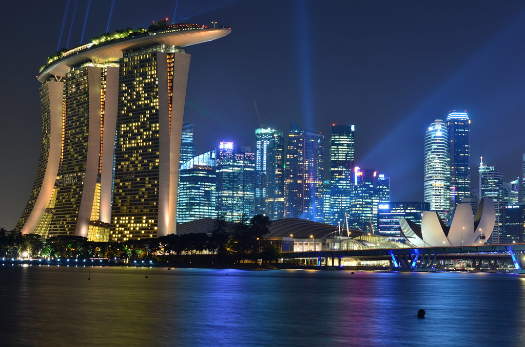Singapore Skyline At Night With Marina Bay Sands In Foreg