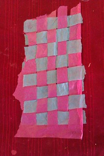 Pink and blue tissue woven together in a grid
