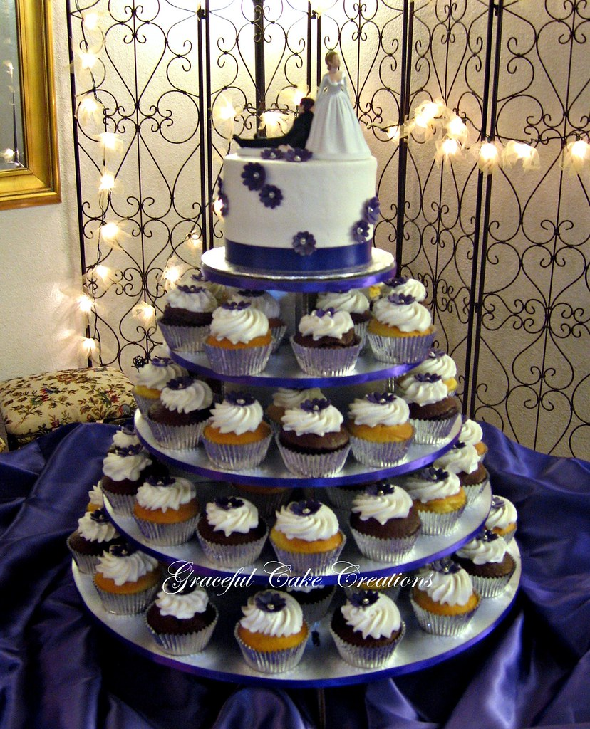 wedding cake to feed 150 cupcake wedding cake with purple flowers grace tari flickr 26286