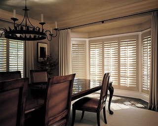 Hunter Douglas Heritance Shutters with Front Tilt in Dining Room | by Blinds & Designs