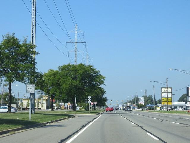 Mile road between detroit and suburban warren michigan by sean