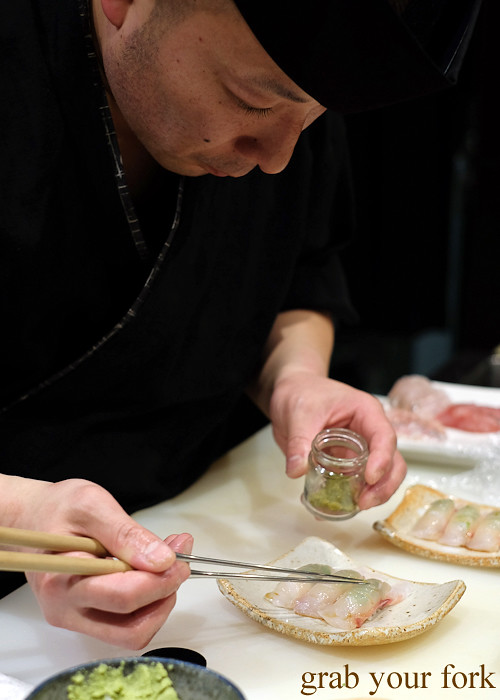 Sushi chef Tomoyuki Matsuya adding yuzu kosho to bass grouper at Hana Ju-Rin in Crows Nest Sydney