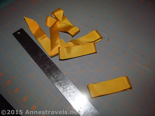 Ribbon, ready to be pinned in place on the adult size seat belt pillow