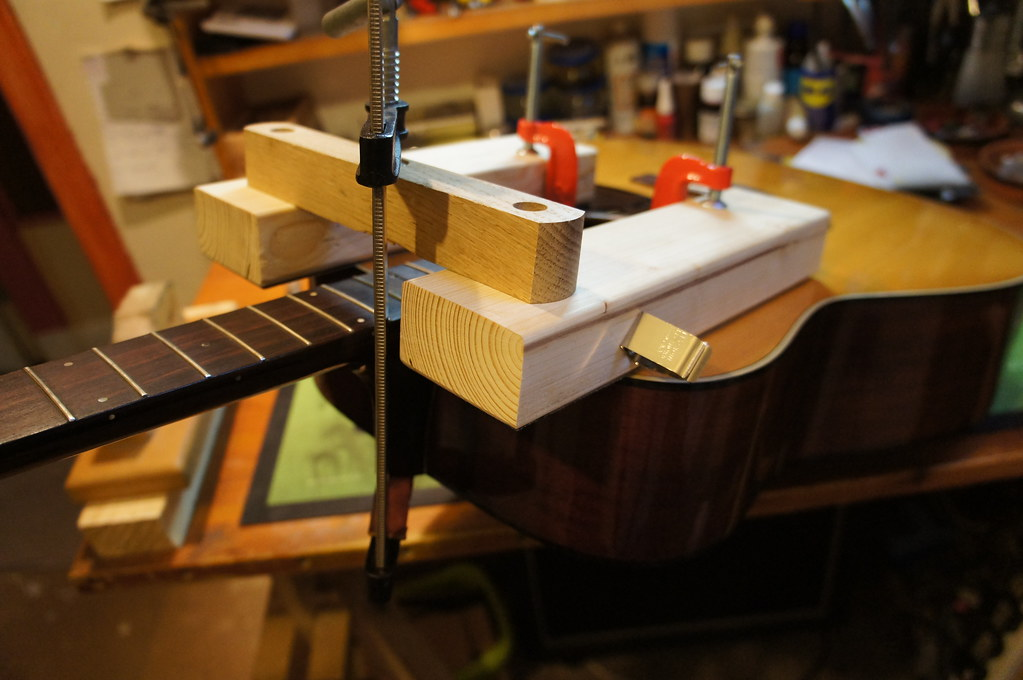 The Acoustic Is Strapped Back Into The Neck Removal Jig T