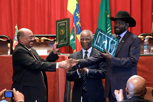 President of Sudan Omar Hassan al-Bashir, former South African President Thabo Mbeki and President Silva Kiir of South Sudan at a cooperation agreement celebration in Ethiopia. The two states have pledged to end differences. | by Pan-African News Wire File Photos