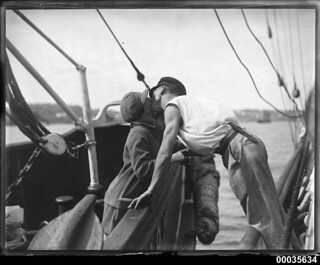 Man and woman kissing across two vessels, 1920-1939 | by Australian National Maritime Museum on The Commons