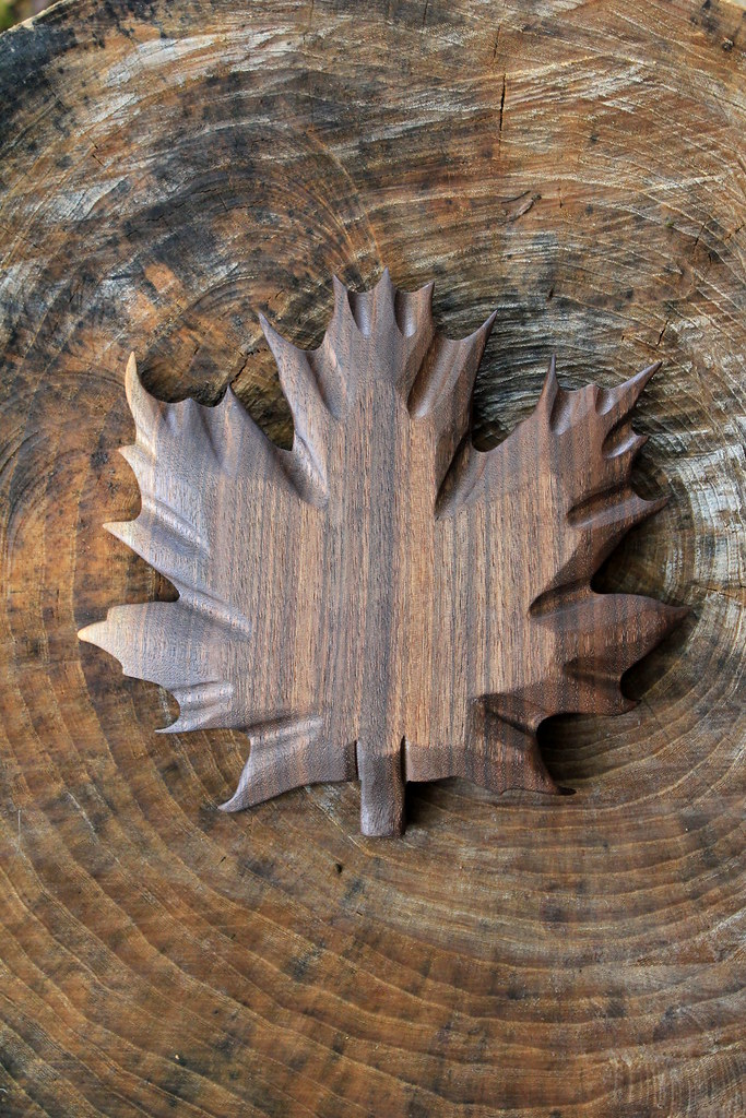 Hand carved maple leaf a i in walnut