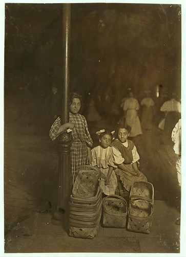 Marie Costa, Basket Seller, 605 Elm St., Sixth St. Market, Cincinnati. 9 P.M. Had been there since 10 A.M. Sister and friend help her.  Location: Cincinnati, Ohio. (LOC) | by The Library of Congress