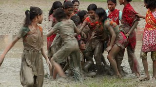 Girls playing soccer in flooded school yard | by World Bank Photo Collection