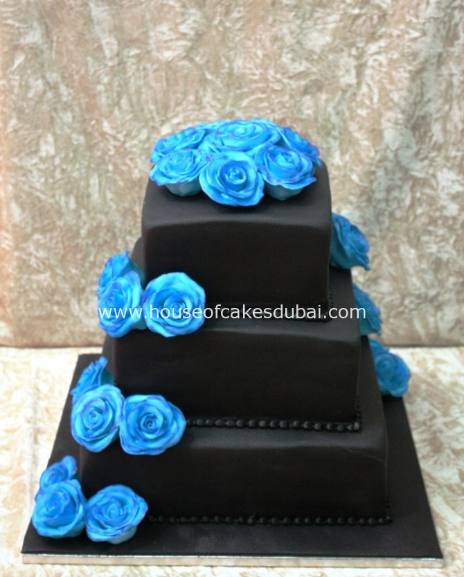Black Cake With Blue Roses By The House Of Cakes Dubai
