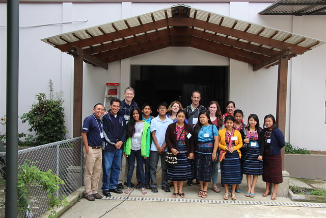 a group of students and tour participants in front of the new educational center