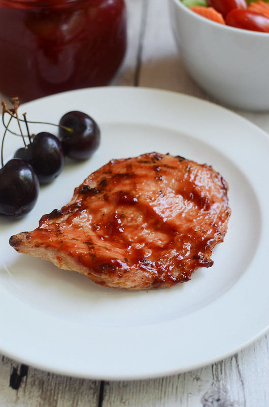 Cherry Bourbon BBQ Sauce - delicious sweet and spicy barbecue sauce made with fresh cherries and Bourbon! Perfect on grilled chicken!