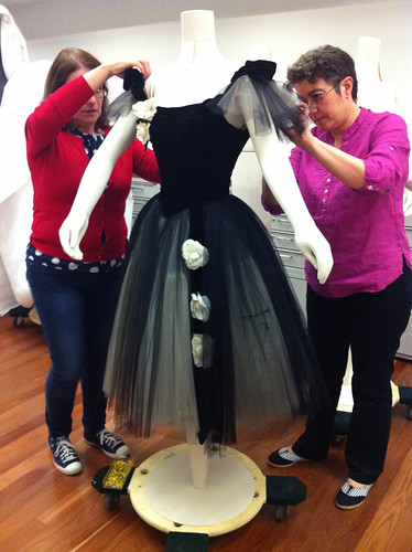 Cristina and Francesca dressing mannequin with dress designed by Cecil Beaton and worn by Margot Fonteyn as Marguerite in Marguerite and Armand, 1963  ©Sarah Bailey Hogarty 2012 | by Royal Opera House Covent Garden