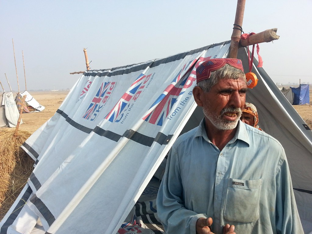 A Pakistani Man Stands Outside A Uk Funded Temporary Shelt