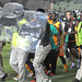 Football players from Ivory Coast seen being escorted off the field in Senegal. The Senegal club is being held responsible for the outbreak of violence in Dakar.