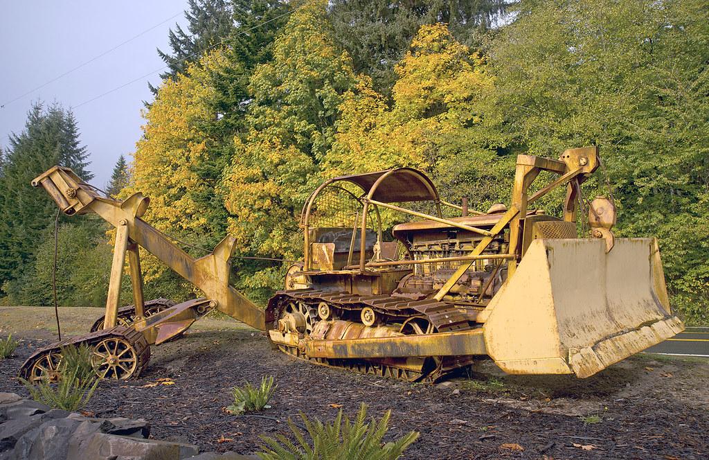 A Caterpillar Diesel Seventy Five Bulldozer And Log Arch