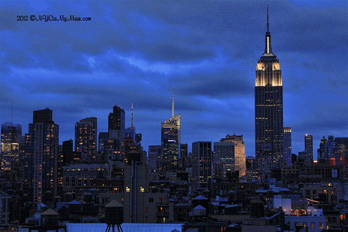 Ominous clouds on NYC Skyline as Hurricane Sandy Approaches, Empire State Building in White | by NYCisMyMuse