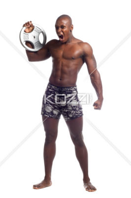 aggressive wrestler holding barbell weight | by people12johnny