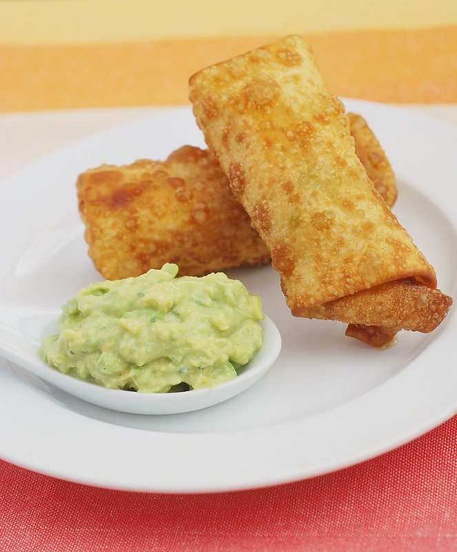 Chicken Club Egg Rolls - the most delicious egg roll recipe! Filled with chicken, bacon, avocado, and cheddar cheese. Plus, an amazing avocado ranch dipping sauce!