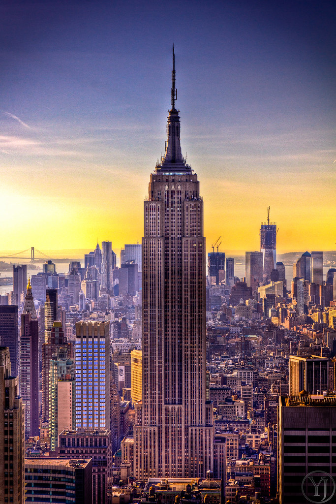 A sunset view of the Empire State Building in New York Cit ... Y Intersection Sign