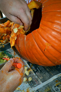 Pulling out the guts of a Pumpkin for carving | by Jeff Rose Photography