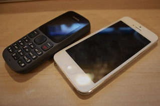 Nokia 100 and Apple iPhone 5 | by Neil T