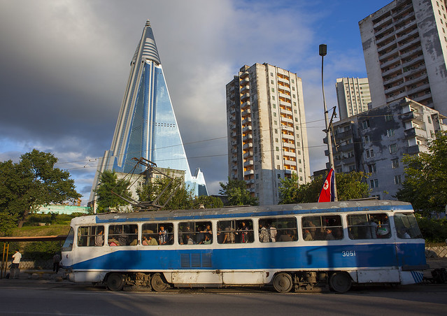 Tramway Passing In Front Of Ryugyong Hotel, Pyongyang, North Korea