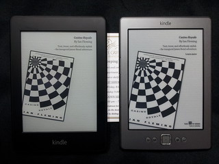 Paperwhite to the left, Kindle 4 to the right. Real, actually white paper in between. | by David Tenser