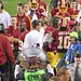 Redskins Offensive Coordinator Kyle Shanahan congratulates RGIII for longest TD run. Happy sideline.