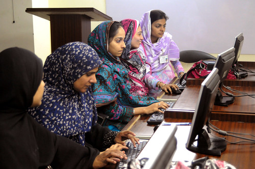 Young women learn computer skills | by World Bank Photo Collection