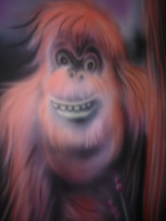 red orangutan monkey smiling black light mini golf cours flickr. Black Bedroom Furniture Sets. Home Design Ideas