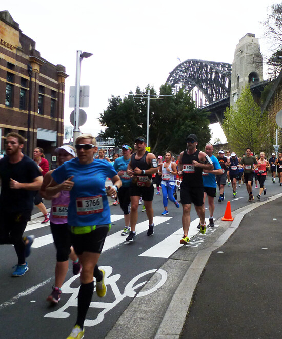 [Lots of runners go through the 8 km point of the Blackmore's Half Marathon]