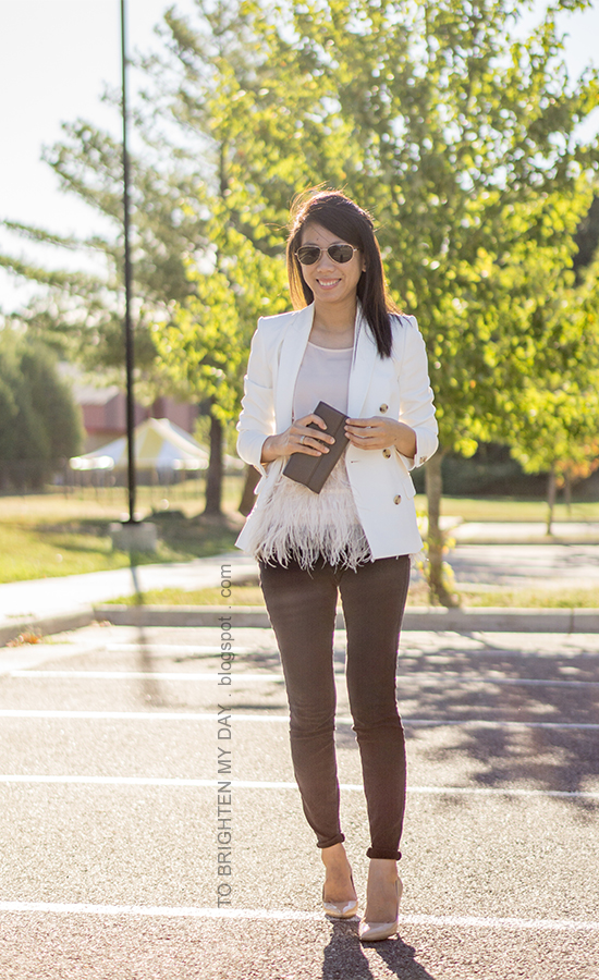 white blazer, feather top, taupe clutch, black jeans, nude pumps