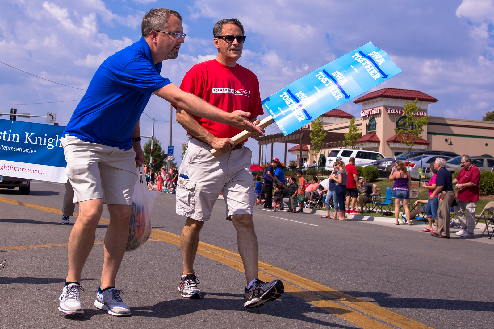 Polk County Auditor Jamie Fitzgerald and Polk County Democrats Chair Tom Henderson walking the parade route.