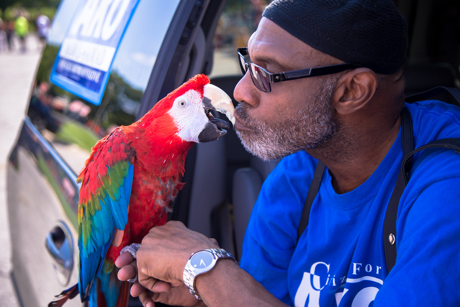 Rep. Ako Abdul-Samad gives his bird a smooch before the parade.