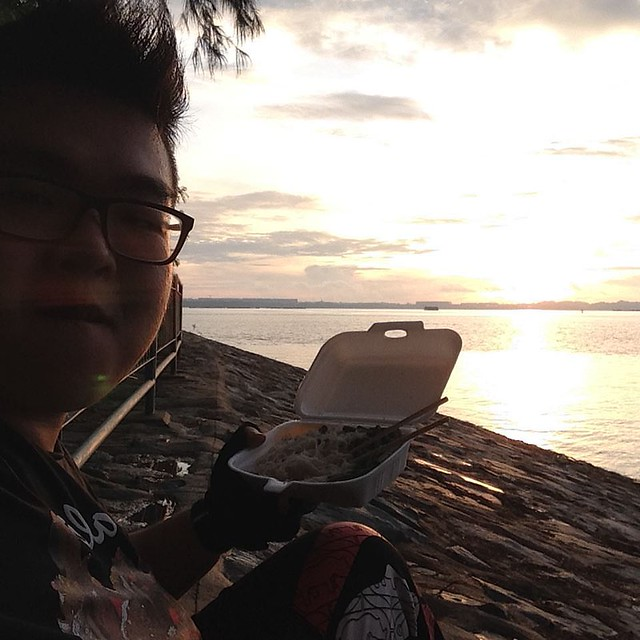 1 enjoying food alone during sunrise
