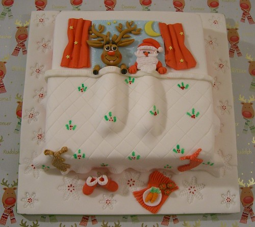 Santa and Rudolph Christmas Cake Trying to get into the ...
