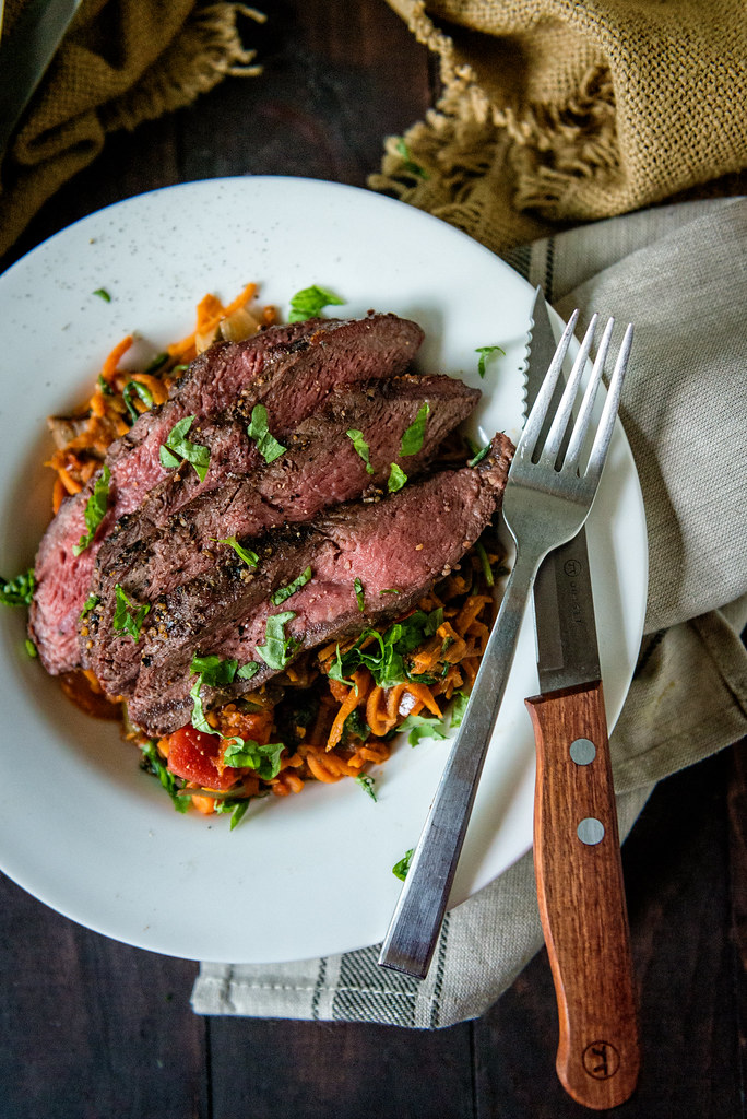 Whole 30 Grilled Flat Iron Steak Over Marinara Tossed Sweet Potato Noodles