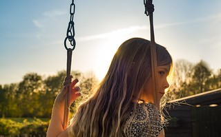 9 year old girl sitting on a swing