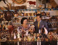 John M. Gonatos in his curio shop with assistant Niki Vasilikis: Tarpon Springs, Florida