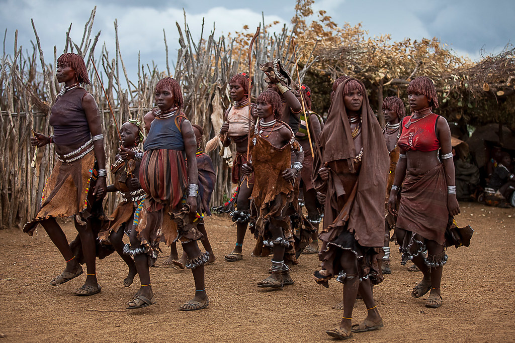 Women tribe hamer dancing during the whipping ceremony, th